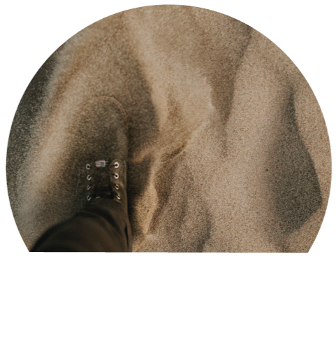 High-angle shot of a man standing in sand.